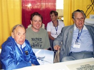 This_photo__was_taken_at_the_Wings_of_the_North_Airshow_in_July_2004___Franz_Stigler_is_on_the_left__Charles_Brown_right__Artist_Jamie_Iverson_center_.jpg